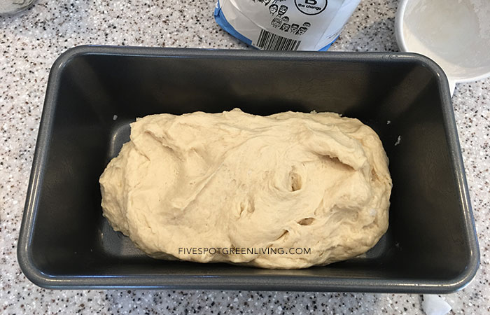 No Knead Homemade Bread Recipe - adding it to pan