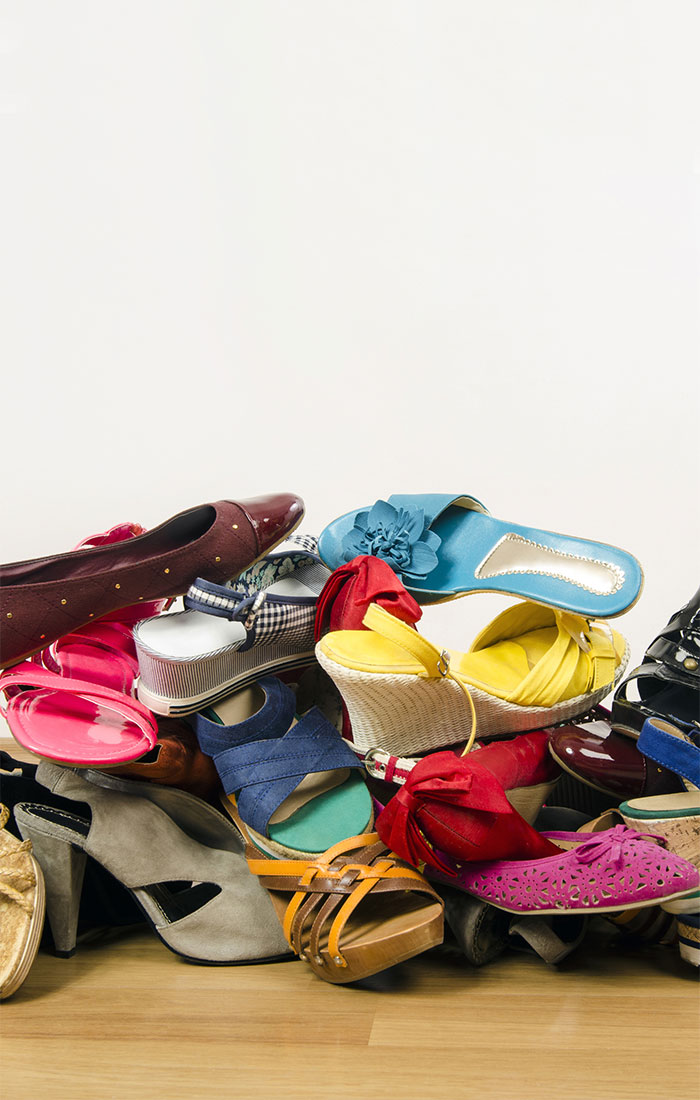 15 Things to Stop Buying to Declutter Your House pile of shoes