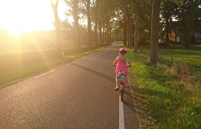 girl riding her bicycle in spring