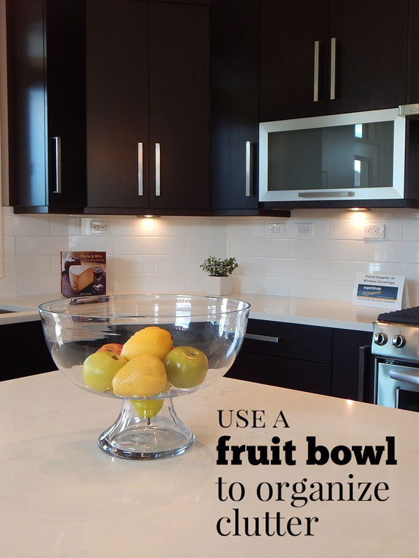 fruit in a bowl on clean organized kitchen counter