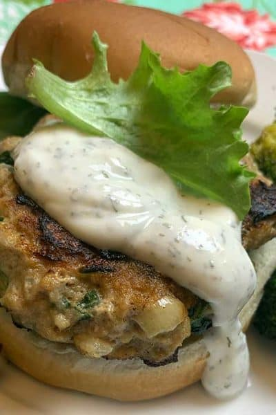 spinach and cheese turkey burger with yogurt sauce
