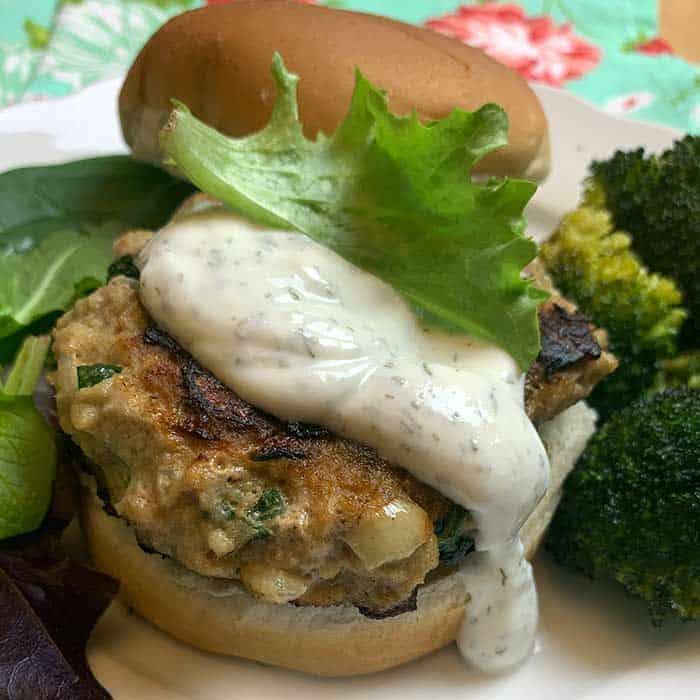 spinach and cheese turkey burger with yogurt sauce