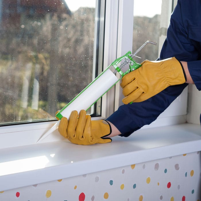 blog-ants-caulk-window How to Keep Ants Out of the House