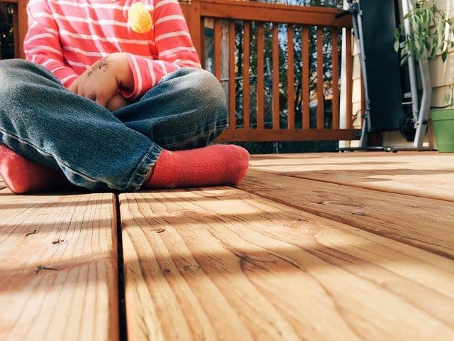 child sitting on deck