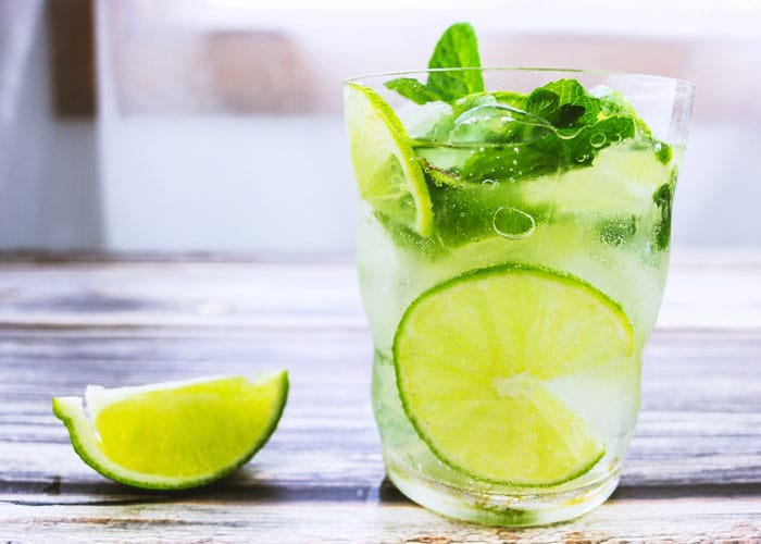 water glass with lemon lime mint