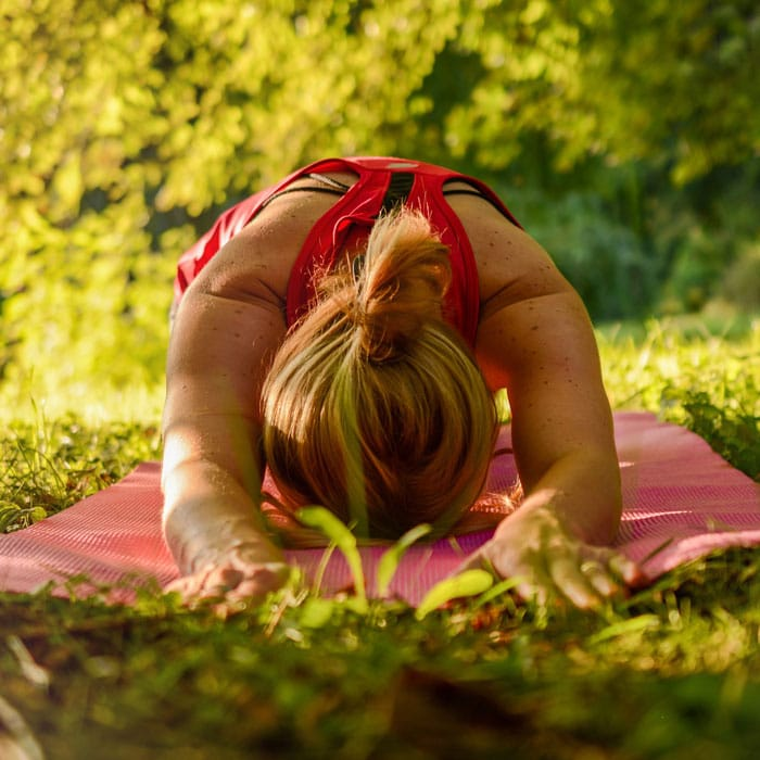 woman doing yoga outside