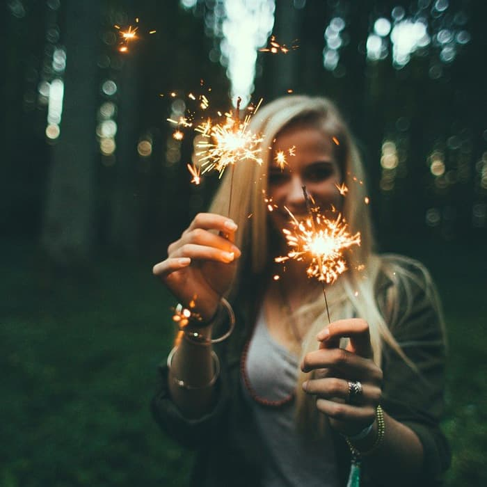 woman with sparklers in hand