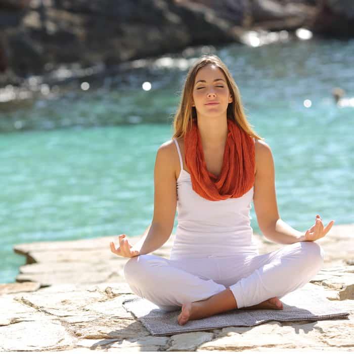 woman doing yoga deep breathing